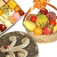 fruit basket with 1/2 kilo cake and Indian sweets