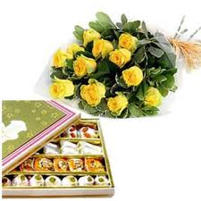 Sweets with yellow roses hand bouquet